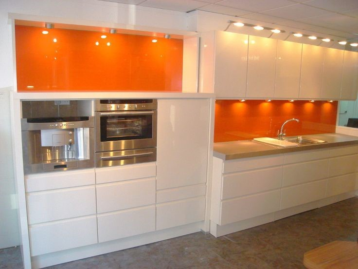 Orange To Brighten Up A White Kitchen