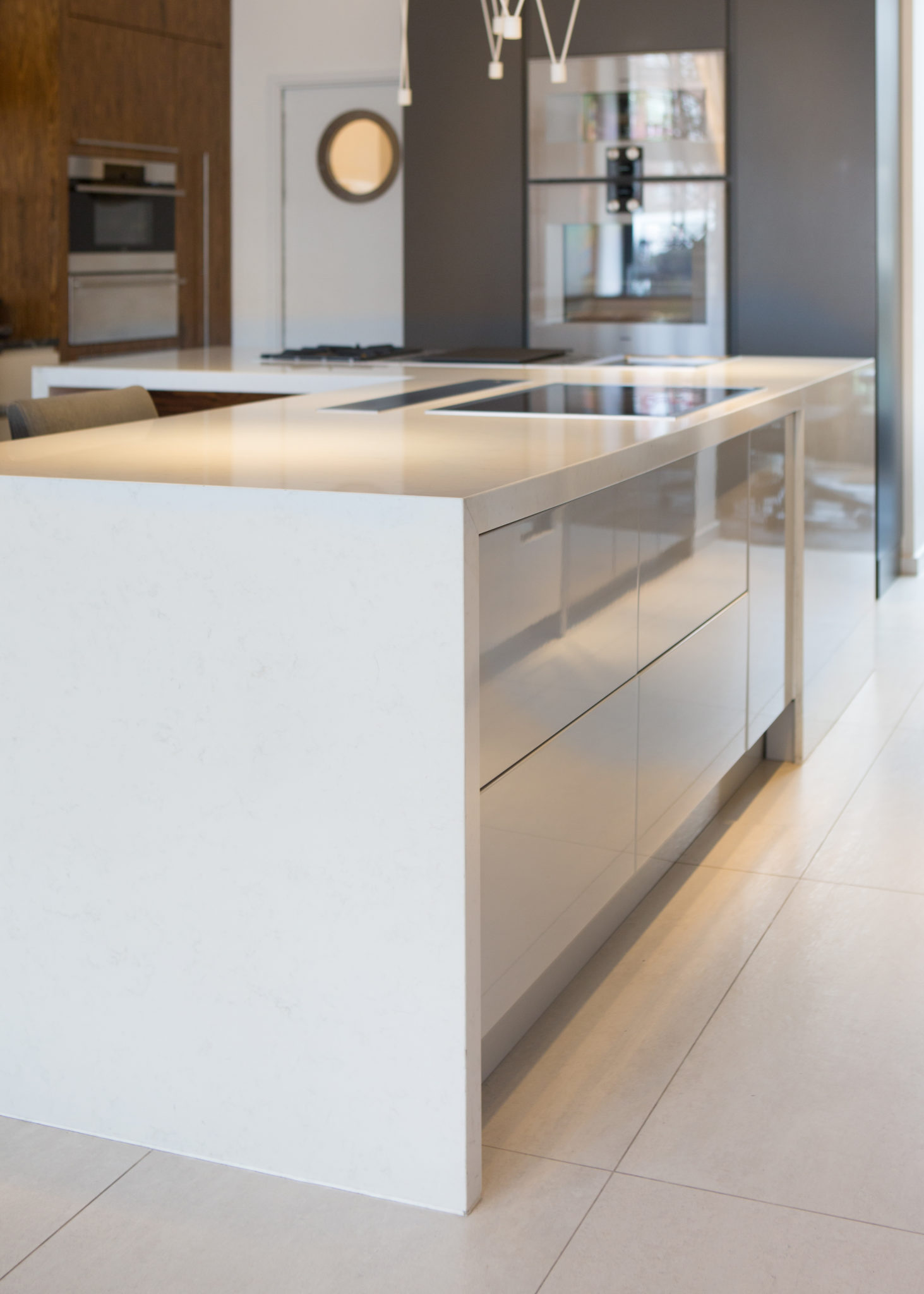 kitchen island with handle-less drawers