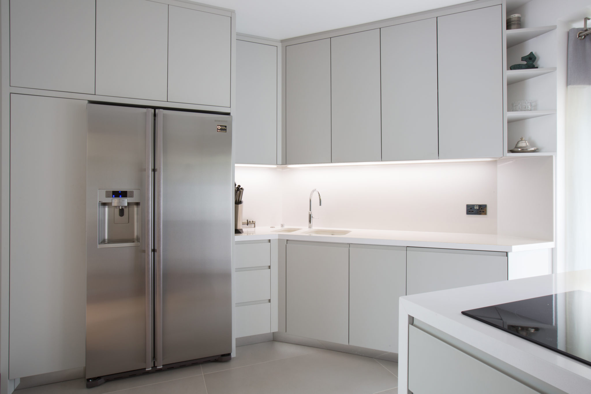 all white handle-less kitchen